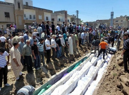 A mass burial in Houla for victims of the May 25 massacre (Reuters)