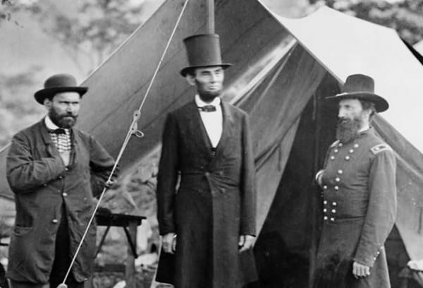 President Abraham Lincoln flanked by Major Alan Pinkteron and General John McClernand at a Union camp in Sharpsburg, Maryland in 1862. (Photo Credit: Bettmann/CORBIS; from History.com)