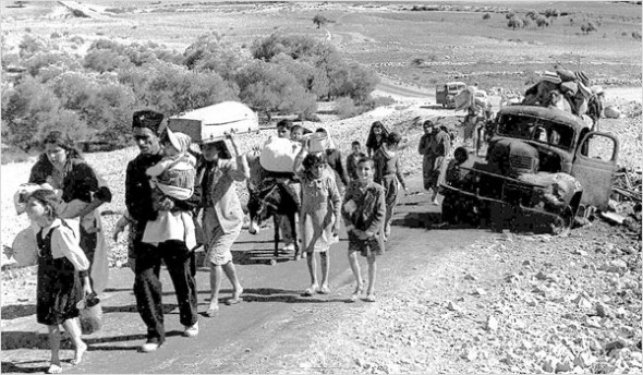 Palestinian refugees flee Galilee in the fall of 1948 (Fred Csasznik)