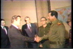 Donald Rumsfeld shakes hands with Saddam Hussein in 1983.