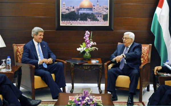 U.S. Secretary of State John Kerry and Palestinian President Mahmoud Abbas in Ramallah on Julyl 19, 2013 (Getty Images)