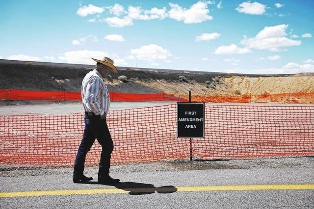 "Cliven Bundy walks by a ""first amendment area"" set up by the Bureau of Land Management near Bunkerville, Nev. Tuesday, April 1, 2014.  (John Locher/Las Vegas Review-Journal)"