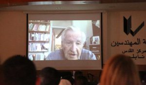 """Noam Chomsky speaking via Skype to the first in a series of conferences titled """"100 Global Thinkers in Palestine"""". (Witness Center for Citizen Rights and Social Development)"""